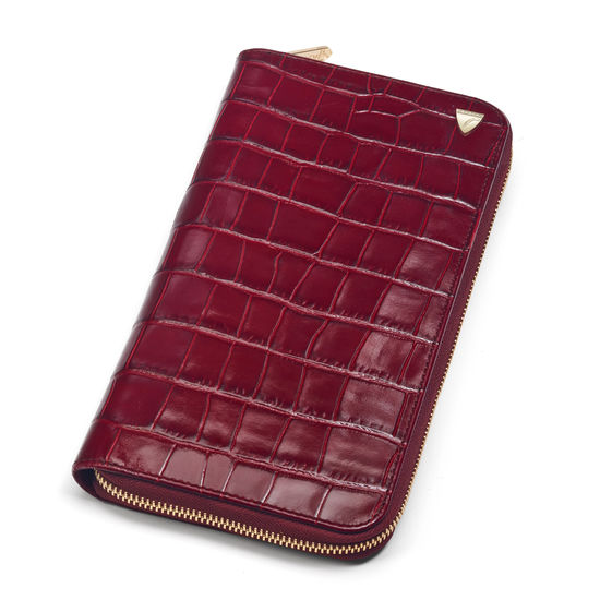 Zipped Travel Wallet with Passport in Deep Shine Bordeaux Croc from Aspinal of London