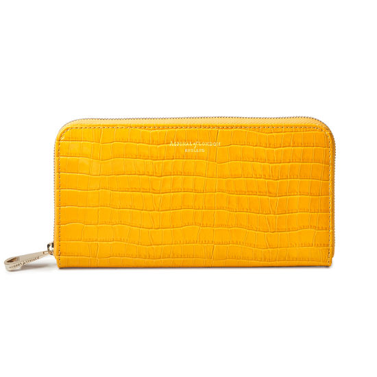 Continental Clutch Zip Wallet in Deep Shine Bright Mustard Small Croc from Aspinal of London
