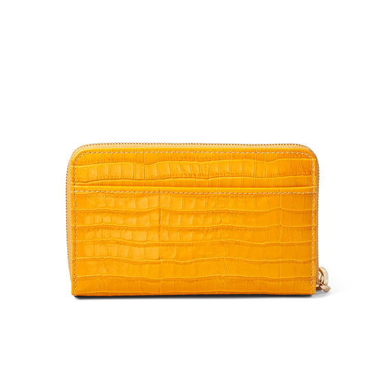 Midi Continental Wallet with Wrist Strap in Deep Shine Bright Mustard Small Croc from Aspinal of London