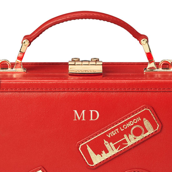 Mini Trunk Clutch in Smooth Scarlet with London Patches from Aspinal of London