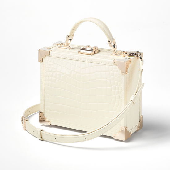 The Trunk in Ivory Patent Croc from Aspinal of London
