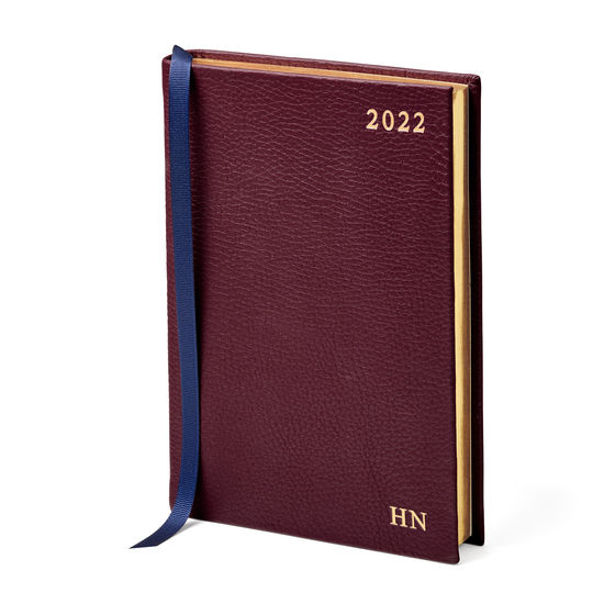 A5 Day to Page Leather Diary in Oxblood Pebble from Aspinal of London