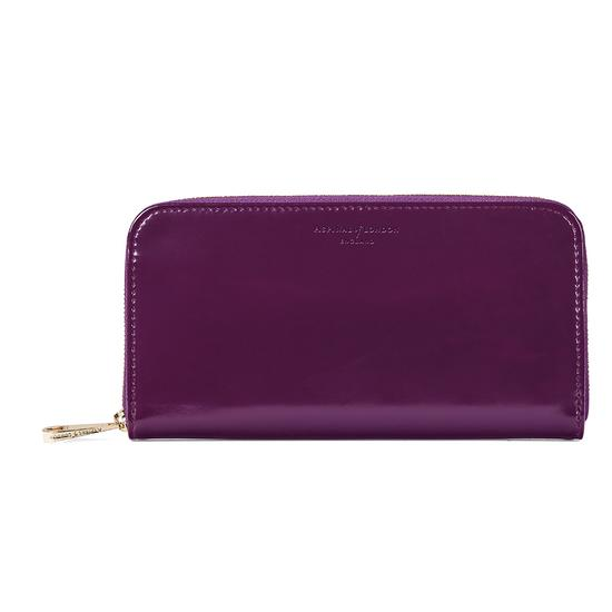 Continental Clutch Zip Wallet in Violet Patent from Aspinal of London