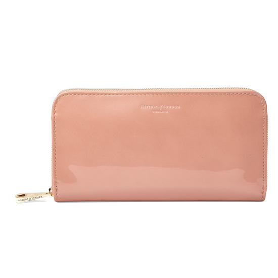 Continental Clutch Zip Wallet in Rose Gold Patent from Aspinal of London