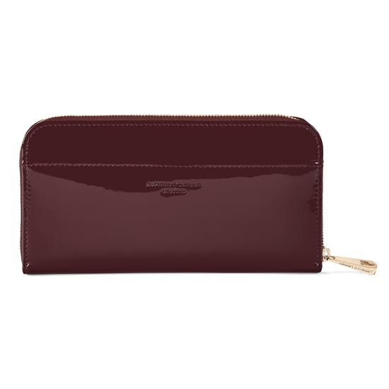 Continental Clutch Zip Wallet in Deep Shine Cherry Patent from Aspinal of London