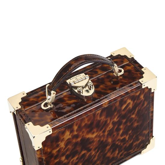 Mini Trunk Clutch in Deep Shine Tortoiseshell Patent from Aspinal of London