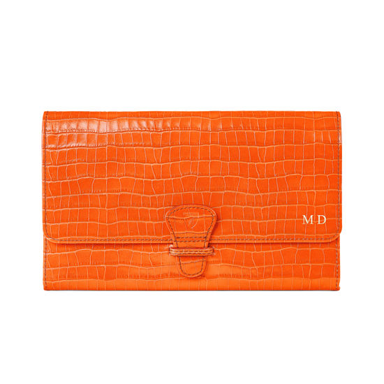 Classic Travel Wallet in Deep Shine Amber Small Croc from Aspinal of London