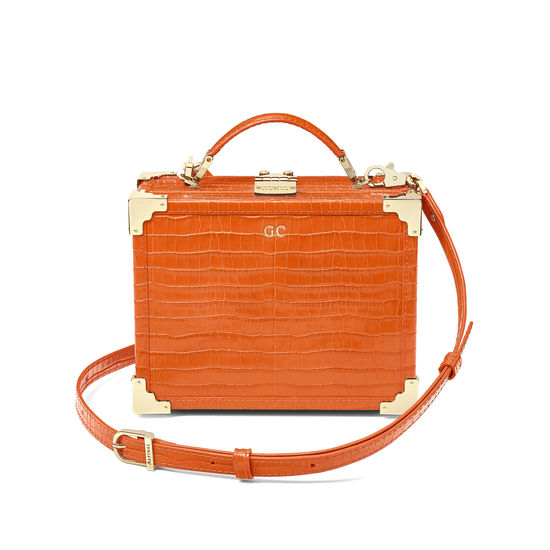 Mini Trunk Clutch in Deep Shine Amber Small Croc from Aspinal of London