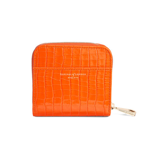 Mini Continental Zipped Coin Purse in Deep Shine Amber Small Croc from Aspinal of London