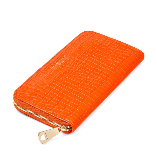Continental Clutch Zip Wallet in Deep Shine Amber Small Croc from Aspinal of London